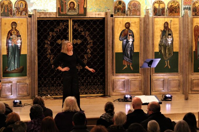 "Guest conductor Marika Kuzma gives a poetry recitation at ""Christmas in Ukraine"" Dec. 21 at St. Demetrios Greek Orthodox Church in Seattle"